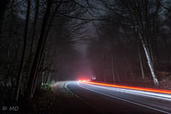 Trails in misty woods (mathieuo1) Tags: chesnay lechesnay brouillard fog forest night mist woods deep urban trails city paris france europe outdoor road path blur bulb emotion imagination composition gitzo light le longexposure art fineart view point trail nightscape nightshoot nikon nighttrail car fire lines shape inspiration test wide discover explore free mathieuo ghost flying dlsr colors blue orange