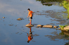 Like Glass (MTSOfan) Tags: boy fishing lake steppingstones goldenhour knightlake reflection