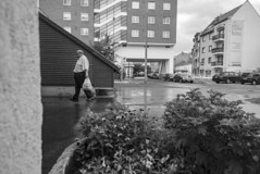 I escaped the rain (David Fóti) Tags: street streetstyle city citylife town house building urban concrete people person man human old elderly rain rainy cloud cloudy black white blackandwhite bw pedestrian miskolc hungary bigcitylife photo photography photograph sony a6500 sonya6500 16mm pancake random onthestreets