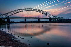 Runcorn Bridge-2 (andyyoung37) Tags: manchestershipcanal runcornbridge waterreflections driftwood rivermersey sunset runcorn england unitedkingdom gb
