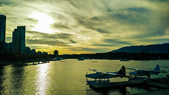 Sunset at Coal Harbour (leewenz) Tags: vancouver canada britishcolumbia sunset water waterplane mountain coalharbour downtown waves travel nature oneplusx