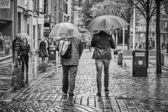 Side by side (tootdood) Tags: canon70d blackandwhite streetcandid market street manchester wet weather rain umbrella brolly sheen sidebyside