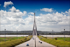 pont de normandie (heavenuphere) Tags: pontdenormandie pont normandie normandybridge lehavre honfleur seinemaritime calvados normandy france europe cablestayed road bridge river seine water motorway cars traffic blue sky clouds landscape symmetry 24105mm