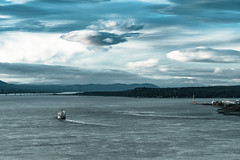 Going Away (Pierre Trudel) Tags: river st lawrence clouds blue quebec bridge boat floating float water