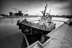 Sinking Mahery (Alec Lux) Tags: ostend abandoned belgium black blackandwhite blackandwhitephotography boat broken coastal landscape landscapephotography long exposure longexposure longexposurephotography nautical oostende port rusty ship shipwreck sinking urban vessel water white wreck vlaanderen be