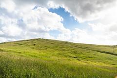 Brudaremossen (xibalbax) Tags: nature hill grass sky clouds sweden