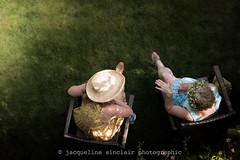 176/365 - Garden Party (Jacqueline Sinclair) Tags: woman women sit sitting grass garden hat straw flower crown dress dresses talking visit visiting talk green yard lawn flickrfriday shotfromabove