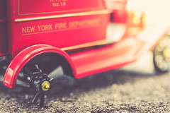 ~A bad attitude is like a flat tire. You can't go anywhere until you change it. (Fire Fighter's Wife {off for awhile}) Tags: truck firetruck tire flattire broken macro macromondays happymacromonday newyorkfiredepartment newyork antique antiquestilllife toy wheel sun sunlight retroprocessing retro vintage vintagestilllife vintageprocessing 40mm nikon nikond750 matte