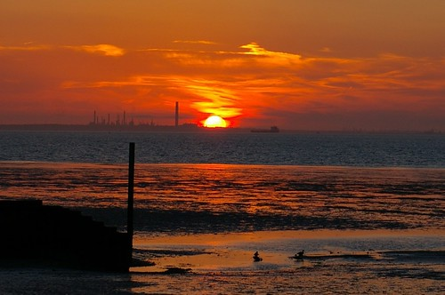 17-254  Ryde Sunset - threee of three;  the sun sinks behind Fawley Oil Refinery