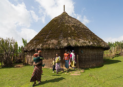 People in front of a Gurage traditional house with thatched roof, Gurage Zone, Butajira, Ethiopia (Eric Lafforgue) Tags: abyssinia africa architecture building built builtstructure butajira children countryside cultures day developingcountries eastafrica ethiopia ethiopia0617431 ethiopian groupofpeople gurage home horizontal hornofafrica house hut indigenousculture nonurbanscene outdoors poverty ruralscene straw tatchedroof thatch thatched thatchedhut thatchedroof tribal tribe tukul women guragezone et