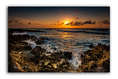 Somehow...   [Explored] (RonnieLMills) Tags: rocky shore stones crashing waves sun reflections clouds seascape sunrise early morning dawn blue sky orange explore explored 9717 8