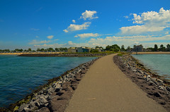 The long and winding road. (alex.vangroningen) Tags: beach rocks pavement sea clouds skyhouses people outdoors sky road