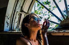 Anna (ivan_volchek) Tags: smoke shine cigarettes girl smoking window rabito devastation hair goggles black neck head paint portrait