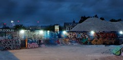 Urban Life (Mars Mann) Tags: graffiti urbanstreets gritty dusk nightphotography dark lights lowlight streetculture artistic shine nocturnal bright brixton bluesky cloudy marsmannphotography streetlights micro43 wasteland abandoned desolation streetart bluehour olympus camera nightshot london