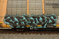 CELOW (TheGraffitiHunters) Tags: graffiti graff spray paint street art colorful freight train tracks benching benched racks autoracks celow