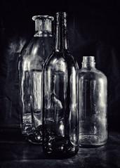 Old Selenium Bottles (christopher.bligh) Tags: bottles stilllife selenium dusty black glass lighting sidelight