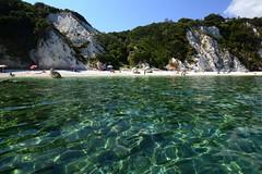 capo Bianco from The Sea (moniq84) Tags: elba sea seascapes capo bianco water sky sun green people summer june tuscany italy island isola