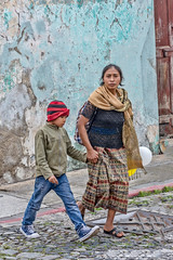 Watch out for the cars (Pejasar) Tags: guatemala antigua 2017 mother son crossingstreet traffic concern caution boy mom redcap