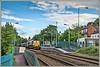 Steeling through the village (david.hayes77) Tags: hawardenroad caergwrle wales borderlandsline 2017 shed class66 dbs ews dbschenker wrexham northwales 66021 6m86 steel freight a550