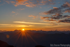 Sunrise Over Mountains (Rick Deacon) Tags: canada orange panorama blue british clouds cold columbia dawn landscape morning mount mountain mountains outdoor seymour snow sun sunrise sunstar wispy