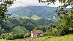 Navarra countryside (Alejandro Hernández Valbuena) Tags: highway driving nature mountains light cold green viewpoint houses basque mountain beans picturesque trees clouds high navarra village landscape town country forrest picks up winter navarre panorama sunset fog etxalar countryside