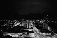 Mogi das Cruzes, SP (Celso Kuwajima) Tags: cityview epsonv800 silverfastai building fujineopanacros100 leicam4 leicasuperangulon13421mm bw citylights nightlights analogphotography mogidascruzes sãopaulo brazil br