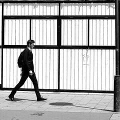 The concentrated man (pascalcolin1) Tags: paris13 homme man mur wall carré square lumière light soleil sun ombre shadow photoderue streetview urbanarte noiretblanc blackandwhite photopascalcolin lampadaire lamppost concentré concentrated