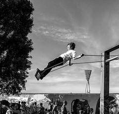 Berlin Swing. #diagonal (seisenschenk) Tags: diagonal berlin festival fetedelamusicque swing boy clouds sky flying flickrfriday playground playing himmel wolken junge spielplatz schaukel baum schwarzweiss blackandwhite einfarbig mauerpark mauer wall