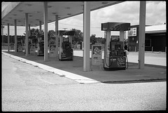 No gas, no waiting. (FreezerOfPhotons) Tags: cosinavoigtlanderbessar3m kmzjupiter350mmf15 fujineopan400 xtol sovieteralens abandoned gasstation outofbusiness gaspump awning concrete metal asphalt paint