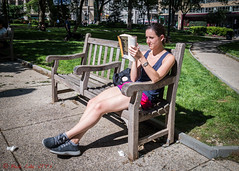 Reading Bonfire of the Vanities (ViewFromTheStreet) Tags: allrightsreserved blick blickcalle blickcallevfts bonfireofthevanities calle citypark copyright2017 park pennsylvania philadelphia photography rittenhouse rittenhousesquare square stphotographia streetphotography viewfromthestreet amazing bench book candid classic female funnyplottedwellcraftedbitterlapels girl grass reading shorts street vftsviewfromthestreet watch woman ©blickcallevfts ©copyright2017blickcalle