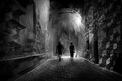 ...exploringancientpaths.. (*ines_maria) Tags: gmünd oldtown künstlerstadt couple street dark blackandwhite bw shadow art mystery man woman person castle together abandoned austria monochrome architecture mono tunnel