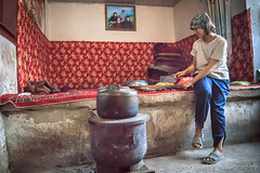 Uyghur Woman Preparing Meal, Turpan, Xinjiang China (Feng Wei Photography) Tags: remoteposition china horizontal uyghurculture asia travel xinjiang woman colorimage tulufan xinjiangprovince turpan uyghur chinaeastasia indoor cn