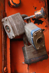 Trio of Master Locks (sherri_lynn) Tags: locks old rusty oldtruck orange masterlocks