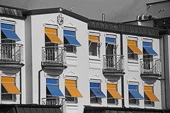 Row of Houses with Marquee behind the dike @ Norderney, Germany ([ PsycBob ]) Tags: dike deich haus häuserfront markisen marquee blue blau orange color splash windows fenster