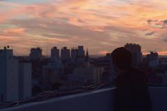 """Admiring the sunset."" (Nahuel Montesino) Tags: winter invierno sunset buildings city citylandscape panoramiccity endofday atardecer alone sky soul suny soledad end freedom frio cold conceptual conceptualphotography clouds cloudy ciudad conceptualpic cam citylights people postal panoramic panorama portrait pensamientos pensante pensar"