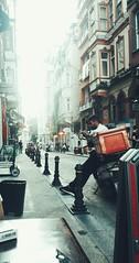 Busy.. (hülyaçam) Tags: streetphoto man waiting streets photography photostyle perspective busy cihangir istanbul turkey color