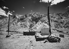 Between the prayer flags [BW] (Modesto Vega) Tags: nikon nikond600 d600 fullframe markha markhavalley mountains ladakh india jammukashmir prayerflags sky maniwall stupa