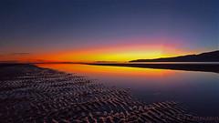 That last ray. (bob_katt) Tags: kapiti island sunset sky rangituhi channel coast colour canon eos500d sea silhouette sand water wave paraparaumu northisland newzealand reflections south
