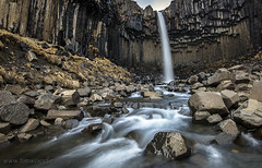 SVARTIFOSS.....ICELAND. (IMAGES OF WALES.... (TIMWOOD)) Tags: iceland south lighthouse waterfall foss island reynisdranger dyrholaey vik troll roadtrip coast sea rough slow shutter skaftafell vatnajokull black falls basalt columns landscape photography photograph tim wood gallery wales bridgend copyright rocks seastacks stacks y myrdall