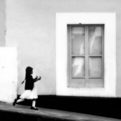 Young Girl with Flowers...Poetic Motion...Otovalo (Rick Exstrom) Tags: rickexstrom ecuador girl flowers street blackandwhite fineart composition walking motion blur