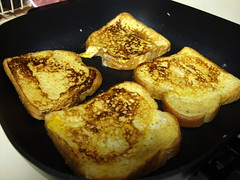 Cooking French Toast. (dccradio) Tags: lumberton nc northcarolina robesoncounty food eat breakfast meal bread frenchtoast indoors sony cybershot w230