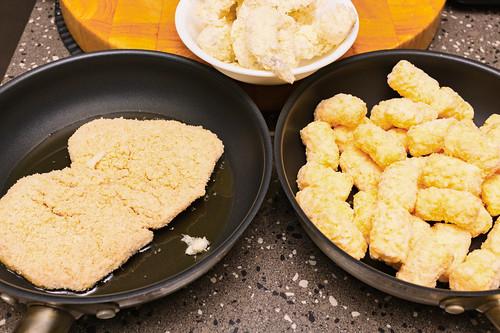 Chicken thigh schnitzel, potato gems and panko prawns