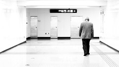Alone in the light (Go-tea 郭天) Tags: qingdaoshi shandongsheng chine cn qingdao metro station indoor inside light white empty alone lonely loneliness feeling walk walking movement through underground old man corridor canon eos 100d 50mm prime street urban city people bw bnw black blackwhite blackandwhite monochrome asia asian china chinese shandong back backside behind candid
