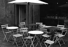 """The Music Room"" Lancaster Ferrania P30 pyrocat HD (Man with Red Eyes) Tags: meta35 p30 p30alpha ferrania 80iso pyrocathd 11100 70f semistand v850 nikonf6 slr 50mmf12 ai analog analogue blackwhite bnw silverhalide monochrome film filmtest filmisnotdead filmtilidie 35mm umbrella chairs coffeeshop themusicroom lancaster lancashire northwest deserted empty"