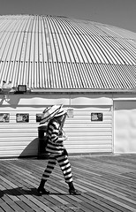 Stripes (Sandrine Vivès-Rotger photography) Tags: england brighton coast pier stripes blackandwhite portrait streetphotography lines costumes costums lignes ponton angleterre holidays woman femme dressingup umbrella scene
