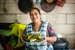 Christmas Tamales with Margarita (mayanfamilies) Tags: mayan families fundaciónfamiliamaya charity mayanfamilies canon eos 5d woman smile smiling laugh laughing kitchen cooking cook pots pans tamale food pot pan tamales huipil stone jewelry earrings