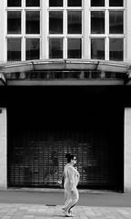 marcher (Harry Halibut) Tags: 2017©andrewpettigrew allrightsreserved contrastbysoftwarelaziness noiretblanc blackwhite blancoynegro blanc weiss noire schwatz bw zwart wit bianco nero branco preto imagesofsheffield images sheffieldarchitecture sheffieldbuildings colourbysoftwarelaziness south yorkshire sheff1706252333 themoor empty shop windows canopy woman walking glass