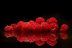 First of the Season (brucetopher) Tags: red raspberry raspberries reflection berry berries juicy reflective reflect shiny fruit garden farm food delicious tasty macrodesserts macro closeup 7d canon100l 100l
