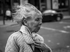 When The Wind Blows (Leanne Boulton) Tags: urban street candid portrait portraiture profile streetphotography candidstreetphotography candidportrait streetportrait streetlife closeup woman female old elderly aged face facial expression look emotion feeling wind windy weather gust breeze wrinkles lines storytelling story weathered hair tone texture detail depthoffield bokeh naturallight outdoor light shade shadow city scene human life living humanity society culture people canon canon5d 5dmarkiii 70mm character ef2470mmf28liiusm black white blackwhite bw mono blackandwhite monochrome glasgow scotland uk