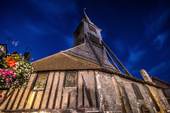 "fine art, late summer night view of the detached bell tower of St Catherine, famous wooden church, Honfleur, Calvados, Normandy, France (grumpybaldprof) Tags: canon 70d ""canon70d"" sigma 1020 1020mm f456 ""sigma1020mmf456dchsm"" ultrawide honfleur normandy normandie france calvados building details colours contrast architectural textures bricks age features wandering streets doors collombage wood timber slate ""halftimbered"" oak plaster traditional norman ""eglisesaintecatherine"" ""stcatherine'schurch"" 'timberbuilt"" ""largesttimberbuiltchurchinfrance"" ""15thcentury"" ""hundredyears'war"" ""foretdetouques"" ""belltower"" ""separatebelltower"" fineart ethereal dark night nocturnal lights blue sky darkbluesky summer latenight colour flowers bell bells steeple wooden ancient medeival eglise bois mood atmosphere moody longexposure old historical"